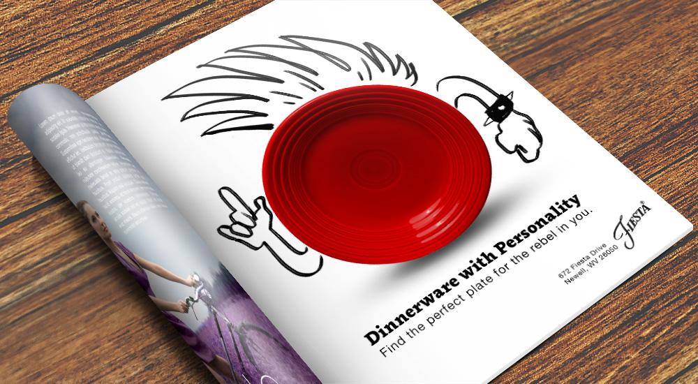 A magazine mock up of one of the ads in the Dinnerware with Personality series. It is a magazine with a page rolled underneath it, with the page still displaying being the page with the advertisment on it. It is the red rebel plate from the series.
